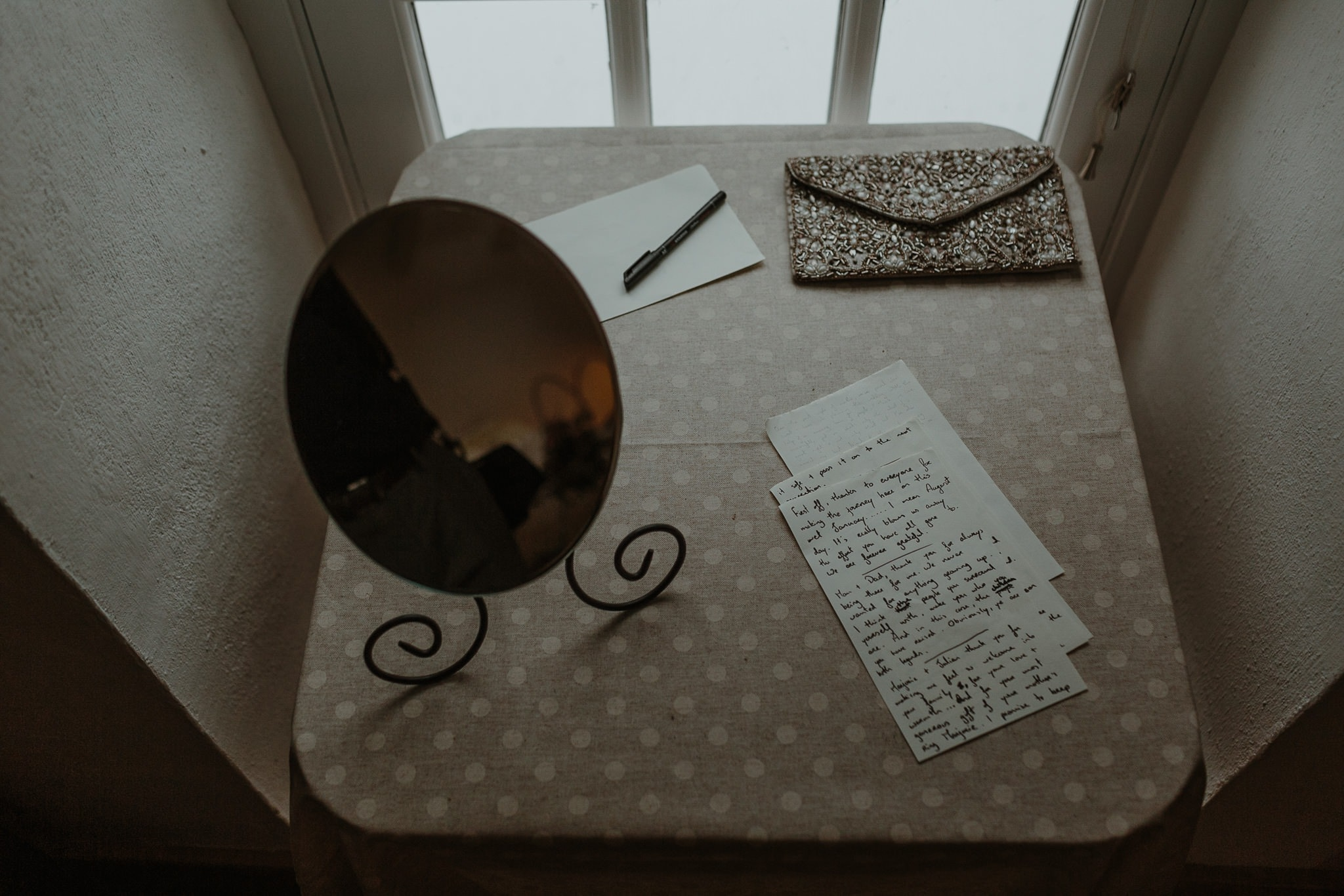 handwritten wedding vows on a table