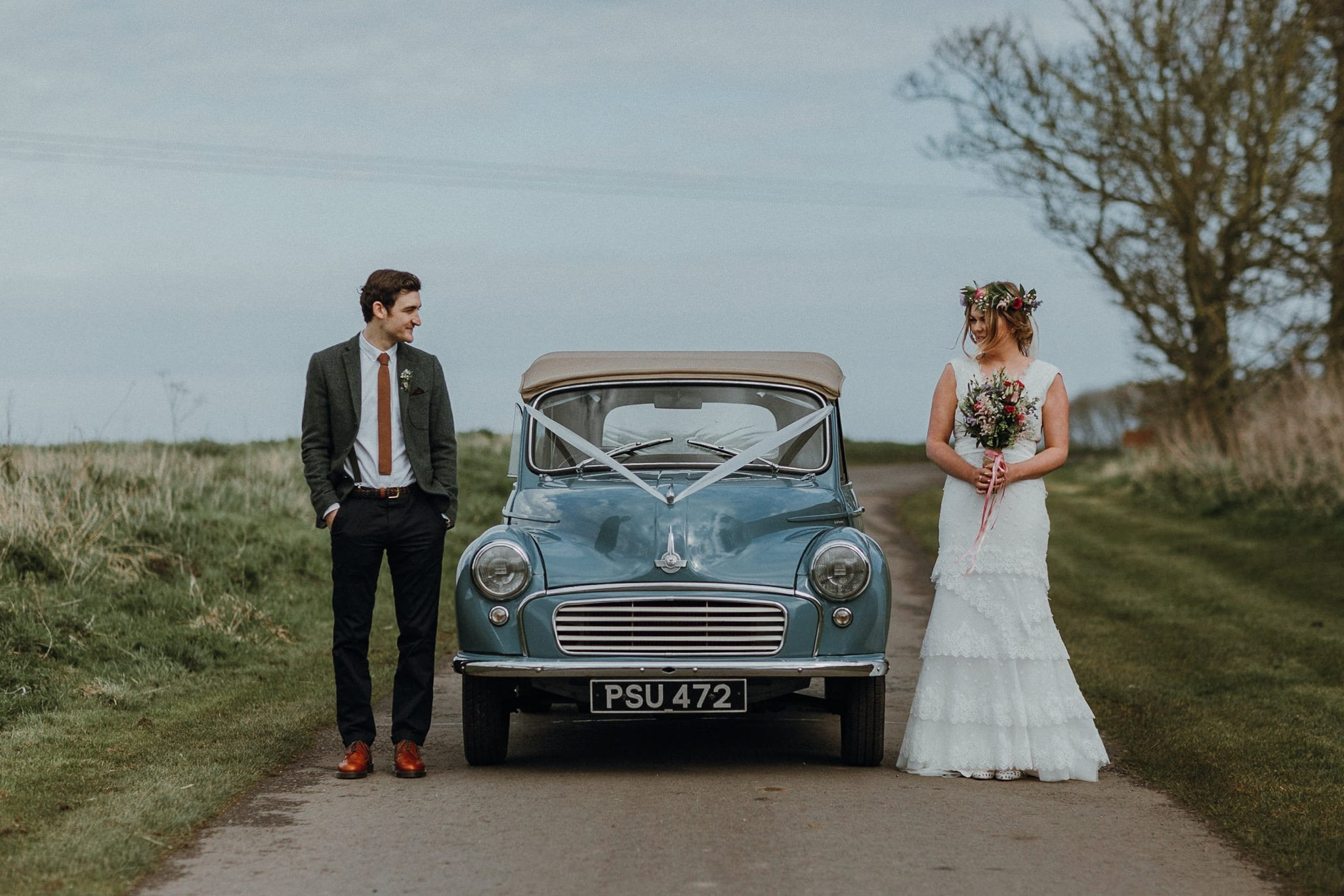 Bride and Groom with Retro Car in the Lane