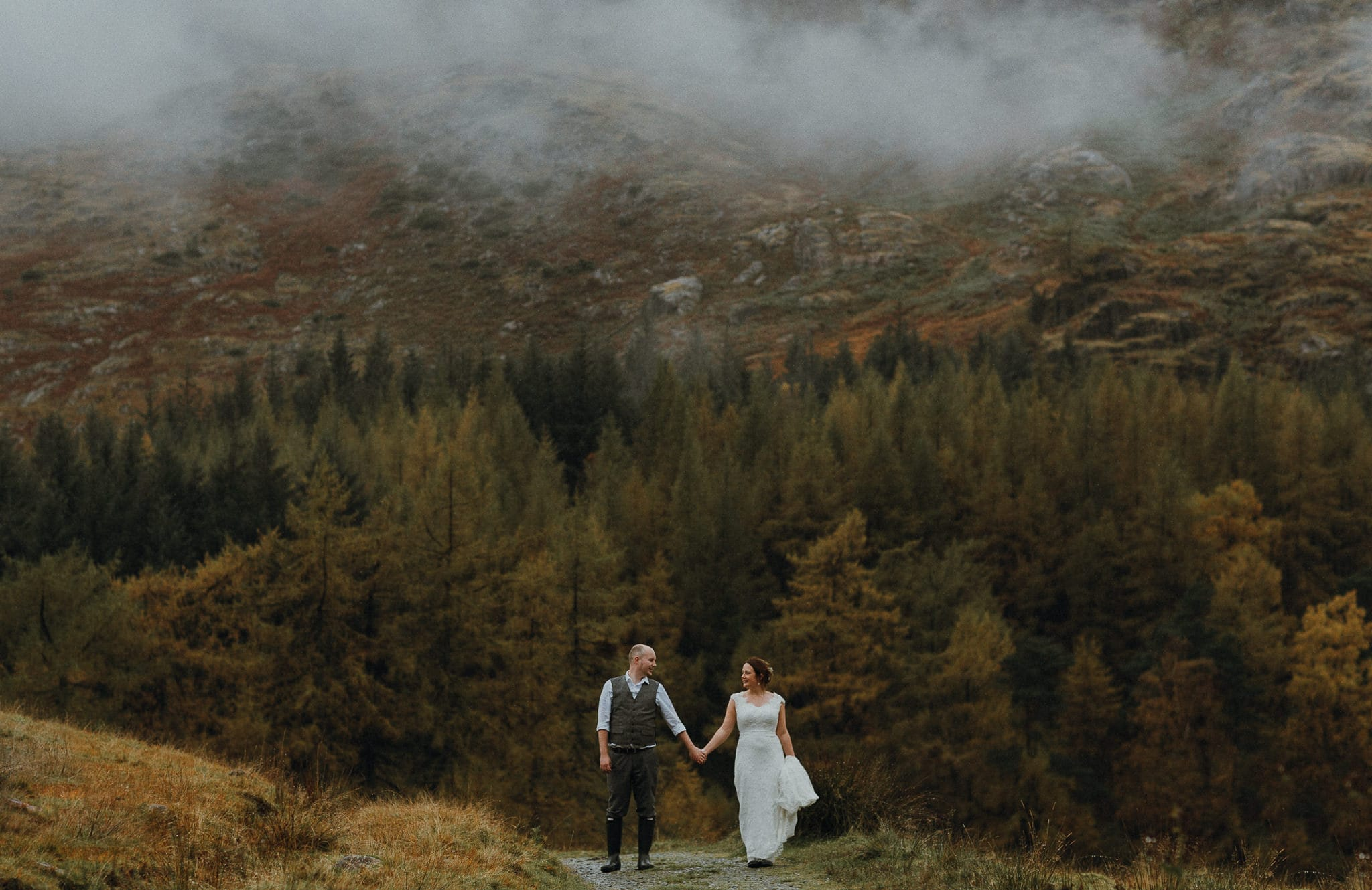 Sharing a moment holding hands at Blea Tarn, Langdale