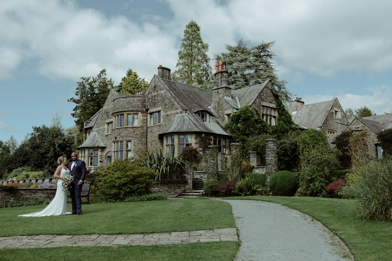 Bride and Groom standing in front of Cragwood Manor